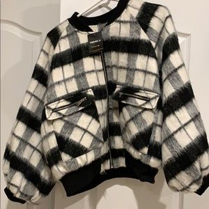 A very chic black and white bomber jacket.